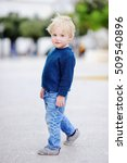 Cute Little Boy Walking On...