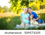 happy family in the park  sit... | Shutterstock . vector #509573335