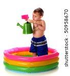 A Preschooler Pouring Water...
