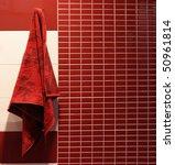 Red Towel Hangs In A Bathroom