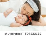 happy family   mother holding... | Shutterstock . vector #509623192