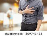 man having heart ache  holding... | Shutterstock . vector #509743435