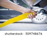 hand holding yellow car towing... | Shutterstock . vector #509748676