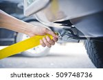 hand holding yellow car towing... | Shutterstock . vector #509748736