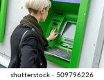 Young Blonde Woman Using Cash...