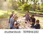 two families having a picnic... | Shutterstock . vector #509846182