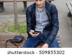 young man using his phone on... | Shutterstock . vector #509855302