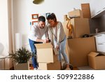 young couple unpacking... | Shutterstock . vector #509922886