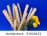 Small photo of Food Backgrounds - snacks. Bread-sticks and yellow aegean wallflower.