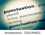 Small photo of Close up of old English dictionary page with word punctuation