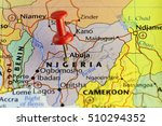 Small photo of Nigeria capitol Abuja pinned map. Copy Space available.