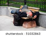 Sleeping Homeless Man On The...