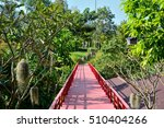 red wooden bridge on green tree ... | Shutterstock . vector #510404266