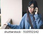 asian girl listening to a call... | Shutterstock . vector #510552142