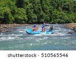 Small photo of Kiulu,Sabah,Borneo-October 22,2011:Group of adventurer enjoying water rafting activity at Kiulu river Sabah,Borneo.The river graded level 1-2.Ideal for family outing & moderately adventurous.