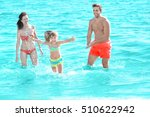 cheerful parents playing with... | Shutterstock . vector #510622942