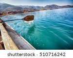 oar of boat touching water and... | Shutterstock . vector #510716242