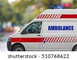 Small photo of Ambulance service van on street