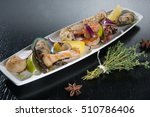 seafood with onions and a lemon | Shutterstock . vector #510786406