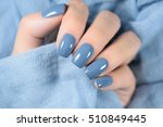 Beautiful Blue Manicure In Light