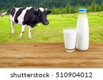 Bottle And Glass Of Milk On...