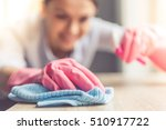 woman in protective gloves is... | Shutterstock . vector #510917722