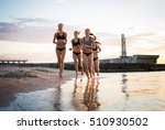 Group Of Young Girls Running O...