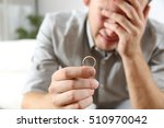 closeup of a sad husband... | Shutterstock . vector #510970042