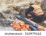 worker lays bricks. repair and... | Shutterstock . vector #510979162