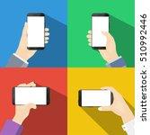 smartphones in hands on colored ...