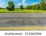 asphalt road and green rice... | Shutterstock . vector #511062046
