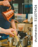 barista brewing drip coffee... | Shutterstock . vector #511075426