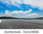 empty asphalt road through... | Shutterstock . vector #511124836