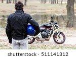 biker standing near motorcycle... | Shutterstock . vector #511141312