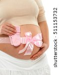Pregnant Woman With Pink Ribbo...