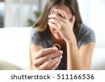 closeup of a single sad wife... | Shutterstock . vector #511166536