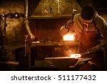 Blacksmith Forging The Molten...