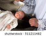 newborn baby being baptized by... | Shutterstock . vector #511211482
