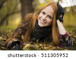 the red face of autumn | Shutterstock . vector #511305952