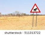 warthog warning road sign in...