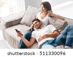 smiling young couple relaxing... | Shutterstock . vector #511330096