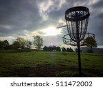 disc golf disc flying into... | Shutterstock . vector #511472002