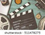 clapperboard and a film reel  a ... | Shutterstock . vector #511478275