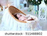Small Babe Lying In Cradle On...