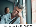 tired man sitting on the bus... | Shutterstock . vector #511501978
