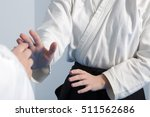 Small photo of Two girls practice Aikido