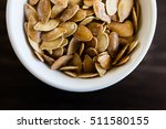 fresh roasted pumpkin seeds... | Shutterstock . vector #511580155