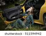 the girl in a green dress sits... | Shutterstock . vector #511594942
