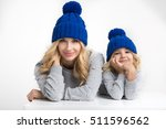 mother and the daughter in hats ... | Shutterstock . vector #511596562