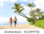 hawaii beach couple walking on... | Shutterstock . vector #511599742